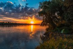 Danube Delta Vegetation and wildlife Sunrise Camping. Camping and sunrise scenery from the wilderness of Danube Delta, blue sky, vegetation and wildlife, raw royalty free stock photo