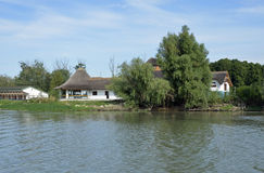 Danube delta villa. Channel forest in danube delta and former hotel of Nicolae Ceausescu royalty free stock photo