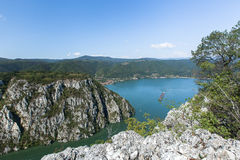 The Danube Gorges Veliki Kazan seen from the Serbian side with a floating ship. Danube gorge iron gate on the Serbian-Romanian border. The Djerdap Gorge is one royalty free stock photo