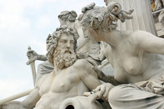 Danube and Inn. Detail of Pallas-Athene fountain in front of Austrian parliament, Vienna, Austria. Sculptures represent rivers Danube and Inn stock photography