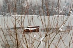 Danube island Šodroš near Novi Sad, Serbia. Colorful landscape with snowy trees, beautiful frozen river. A boats covered with s. Now or submerged royalty free stock image