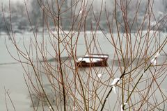Danube island Šodroš near Novi Sad, Serbia. Colorful landscape with snowy trees, beautiful frozen river. A boats covered with s. Now or submerged stock photos