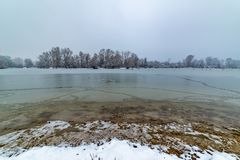 Danube island Šodroš near Novi Sad, Serbia. Colorful landscape with snowy trees, beautiful frozen river. Danube island Šodroš near Novi Sad, Serbia royalty free stock image