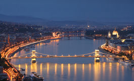 The Danube by night in Budapest, Hungary. A night scape over the beautiful Szechenyi Chain Bridge over the Danube, in Budapest Royalty Free Stock Images