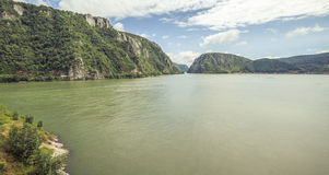 Danube river at Cazanele Mari. With big rocky mountains stock images