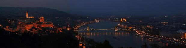 Panoramic view from Géllert Hill at sunset in Budapest Hungary. The Danube river, Chain Bridge and Buda castle illuminated as main elements of the landscape royalty free stock images