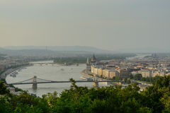 Danube river crossing Budapest. Budapest cityscape from the Gellert Hill featuring the Danube river, the Chain bridge and the Hungarian parliament building Royalty Free Stock Images