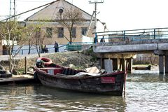 Danube river and fishing boat near the shore on a spring day. Channels along the streets like in Venice. Coast with reeds and water with a duckweed. Vilkovo royalty free stock photos