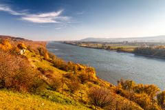Danube river flowing through the landscape at autumn. Danube river flowing through the landscape in autumn colors royalty free stock photos