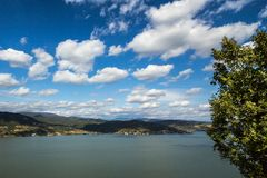 Danube river near the Serbian city of Donji Milanovac in the Iron Gates, also known as Djerdap, which are the Danube gorges. A natural symbol of the border royalty free stock photo