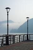 Danube river promenade at city of Golubac,old fortress in a mist Stock Image