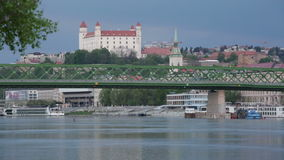 Danube river view, bridge and  Medieval castle in Bratislava stock video footage