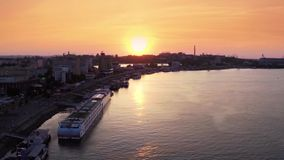 Danube at sunset aerial view. Aerial view of Tulcea city harbor and the Danube before flowing into the sea stock video footage