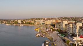 Danube at sunset aerial view. Aerial view of Tulcea city harbor and the Danube before flowing into the sea stock video