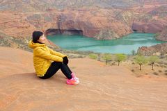 Danxia landform. The Chinese woman is enjoy scenery of Danxia landform in Longzhou, Jinbian, Shaanxi, China Stock Images