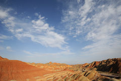 Danxia landform with clouds Royalty Free Stock Photography