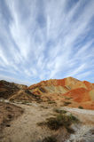 Danxia landform with clouds Royalty Free Stock Image