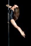 Danza atractiva joven del poste del ejercicio de la mujer Imagenes de archivo