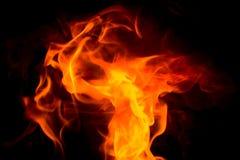 Danza de la llama en color rojo y amarillo Fondo negro fotografía de archivo