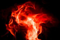 Danza de la llama en color rojo y blanco Fondo negro foto de archivo