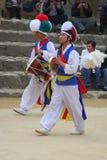 Danza de los granjeros en la aldea popular coreana Imagen de archivo