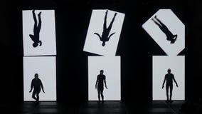 Danza de sombras Bailarines que bailan en la etapa Siluetas de los bailarines Sombras de la danza demostración de la danza 3D almacen de metraje de vídeo