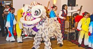 Danza del dragón en el Año Nuevo chino en Inverness 2014 Imágenes de archivo libres de regalías