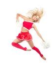 Danzatore della ragazza pon pon dal salto cheerleading della squadra Immagine Stock Libera da Diritti