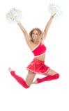 Danzatore della ragazza pon pon dal salto cheerleading della squadra Fotografie Stock
