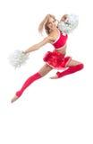 Danzatore della ragazza pon pon dal salto cheerleading della squadra Fotografia Stock
