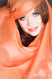 Danzatore di pancia in arancio Immagine Stock