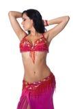 Danzatore di pancia che porta un costume di colore rosa caldo Fotografia Stock