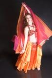 Danzatore di pancia nel colore rosso Fotografia Stock
