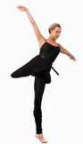 Danzatore femminile che si leva in piedi su un piede Fotografia Stock Libera da Diritti