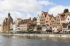 Danzig, Poland - July 7 2016: Gdansk old city in Poland. With the oldest medieval port crane Zuraw in Europe and a promenade along the riverbank of Motlawa Royalty Free Stock Photo