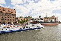 Danzig, Poland - July 7 2016: A moderne cruise ship on Motlawa river. Danzig, Poland - July 7 2016: A moderne cruise ship on Motlawa Mottlau river in old city of Royalty Free Stock Image
