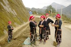 Dao red ethnic group of women. On the way towards Sapa Muong Hum near the Chinese border of Red Dao women are road works at the roadside Royalty Free Stock Images