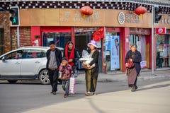 Unidentified tibetan people walking in Daocheng Royalty Free Stock Photo