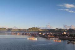 Dapa Siargao town daybreak. DAPA CITY, SIARGAO ISLAND, MINDANAO, PHILIPPINES - NOVEMBER 3: daybreak with lit hilltops and early morning fog in a small, remote Royalty Free Stock Photos