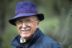 Dapper senior man in blue hat. Jaunty older man in blue hat and with a mustache Royalty Free Stock Photo