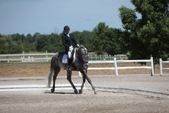 Dapple Gray Dressage Horse and Rider at a show Royalty Free Stock Images