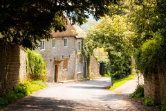 Dappled light. In the Dorset village of Melbury Osmond with cottages in the background stock images