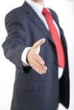 Dar la bienvenida al hombre de negocios Foto de archivo libre de regalías