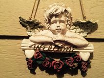 Dar la bienvenida a amor del ángel Foto de archivo