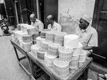 DArajani market. People selling muslim cups called taqiyah on a stand in Darajani Market in Stone Town on Zanzibar Royalty Free Stock Photo