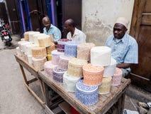 Darajani market. People selling muslim cups called taqiyah on a stand in Darajani Market in Stone Town on Zanzibar Royalty Free Stock Photos