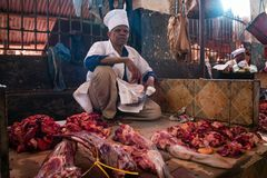 Darajani Market in Stone Town, Zanzibar. STONE TOWN, ZANZIBAR - DEC 31, 2017: Seller offers fresh beef meat at Darajani Market in Stone Town, Zanzibar stock photo