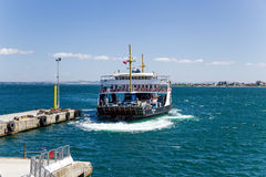 Dardanelles, Turkey. Car ferry makes docking using thrusters royalty free stock images