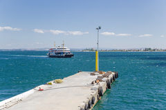 Dardanelles, Turkey. The ferry is approaching the pier in the Strait of Dardanelles Royalty Free Stock Photography