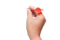 Dardo della holding della mano immagine stock